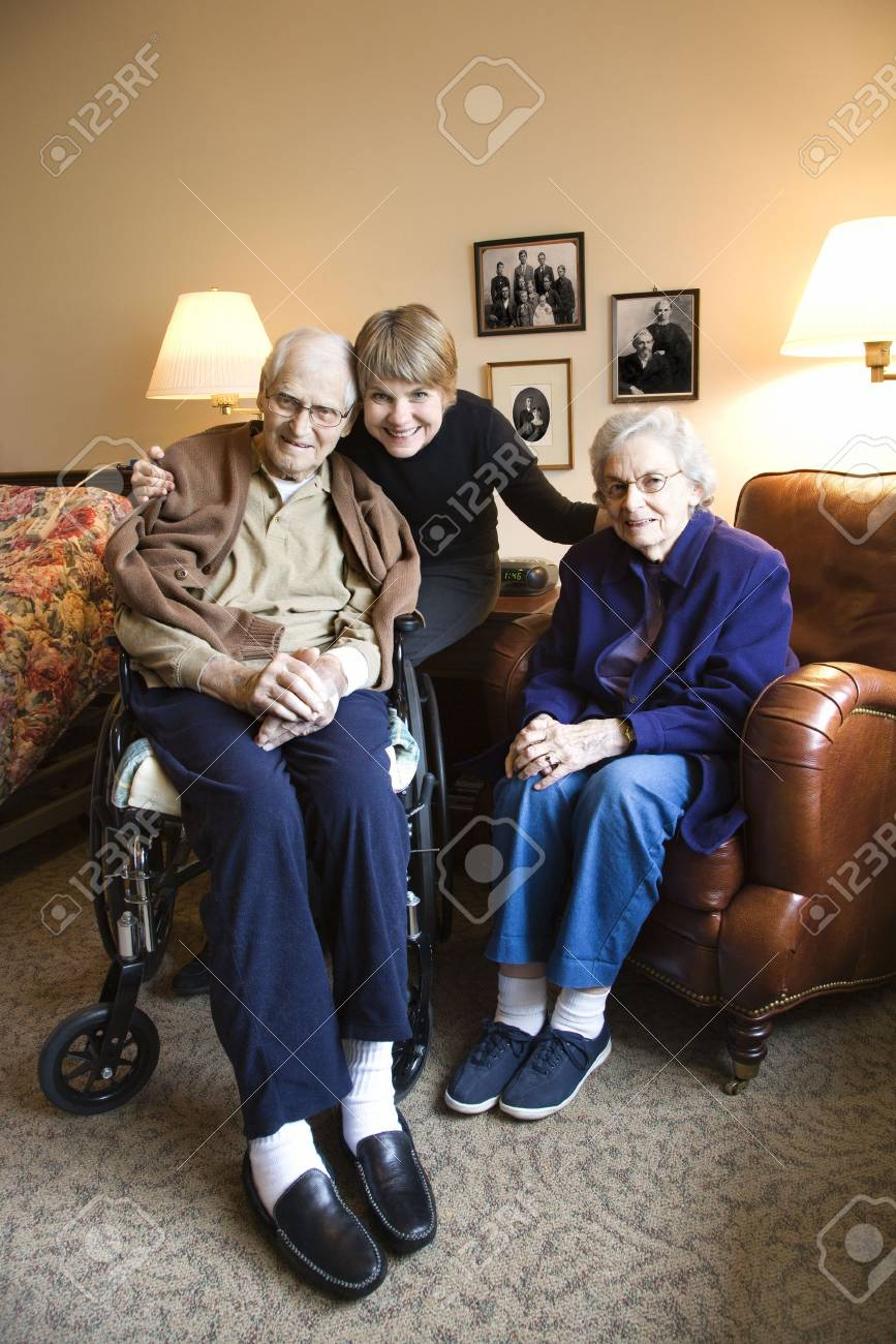 Caucasian middle-aged daughter with elderly parents in retirement community center. Stock Photo - 1806829
