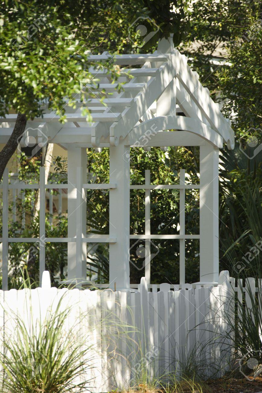 Garden Arbor With White Picket Fence. Stock Photo   1795744