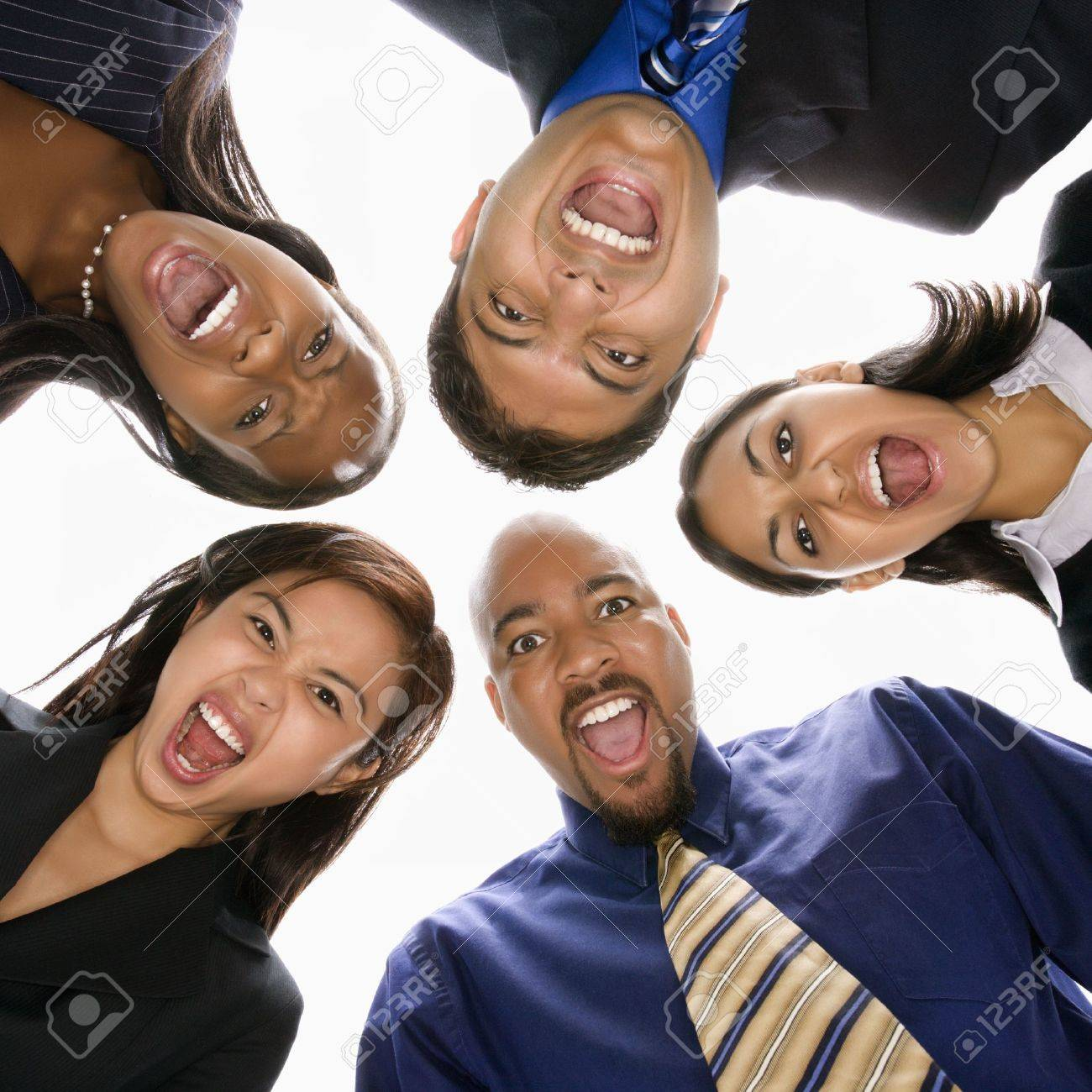 Low angle portrait  of multi-ethnic business group of men and women in huddle screaming. Stock Photo - 1796868