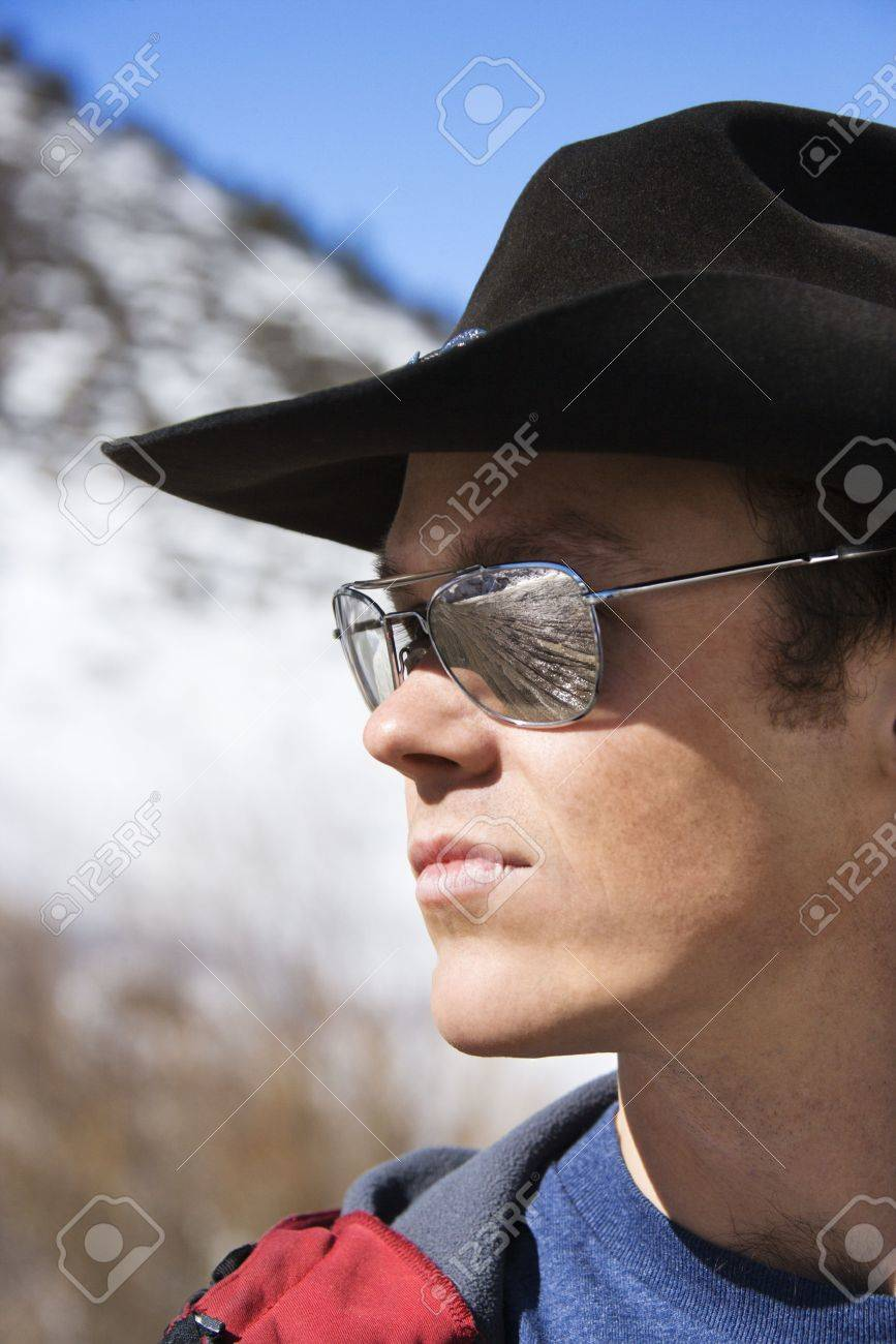 76ececb80834 Mid-adult Caucasian male wearing sunglasses and cowboy hat. Stock Photo -  1850503