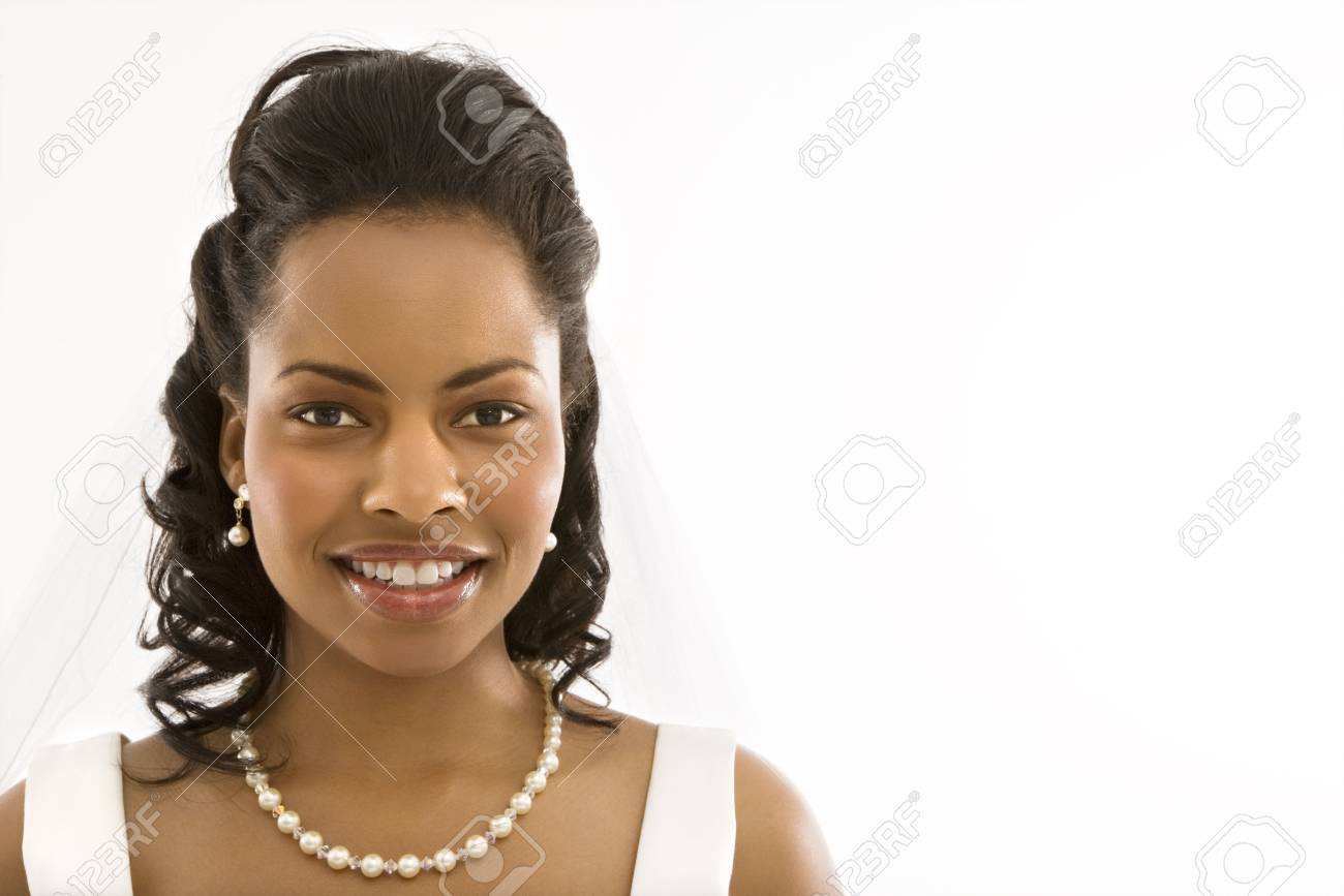Portrait of a mid-adult African-American bride on white background. Stock Photo - 1858908