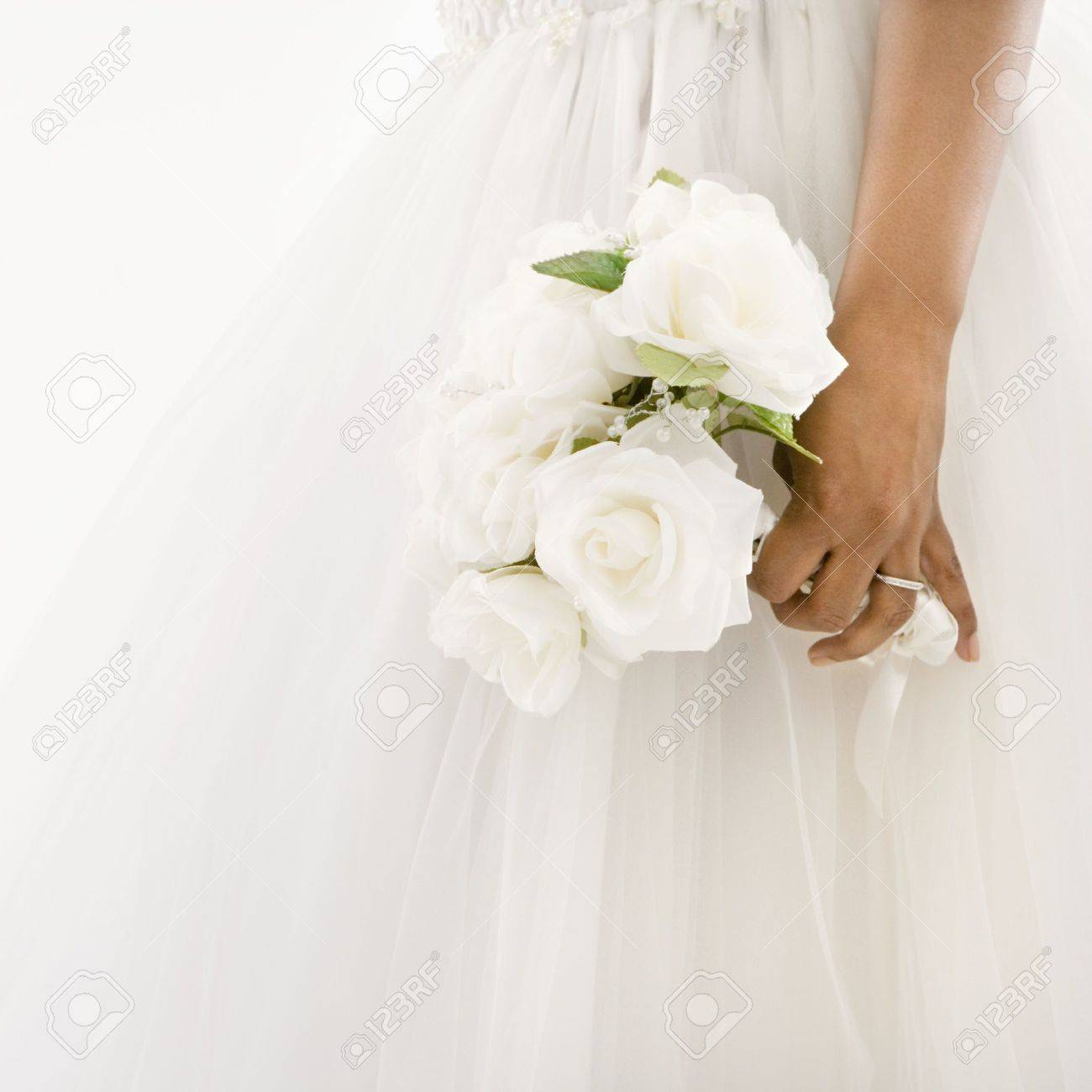 African-American bride holding bouquet. Stock Photo - 1858835
