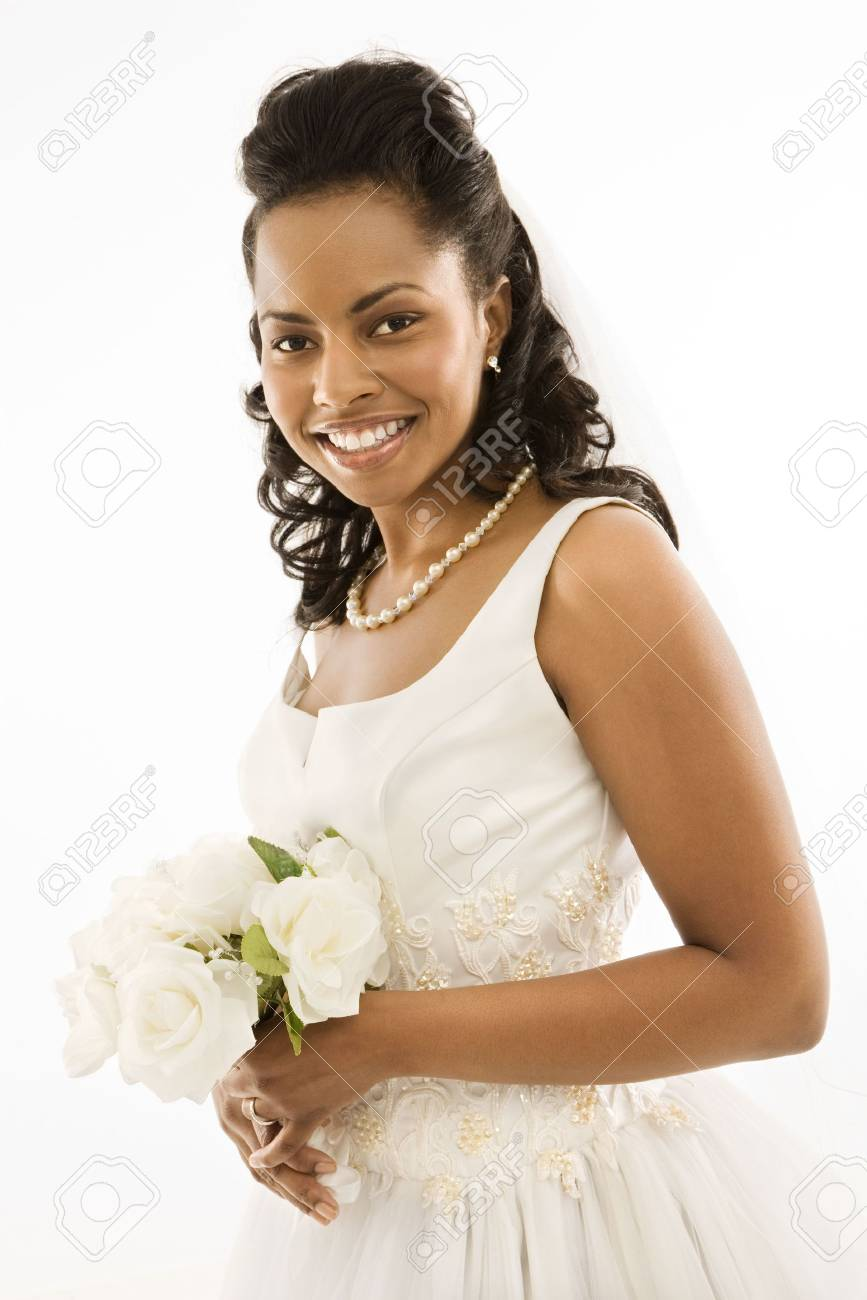 Portrait of a mid-adult African-American bride holding bouquet. Stock Photo - 1858937