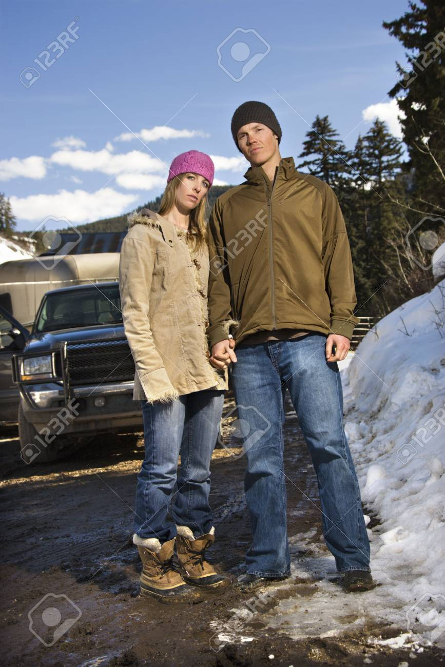 Young Caucasian couple holding hands looking at viewer with truck in background. Stock Photo - 1859145