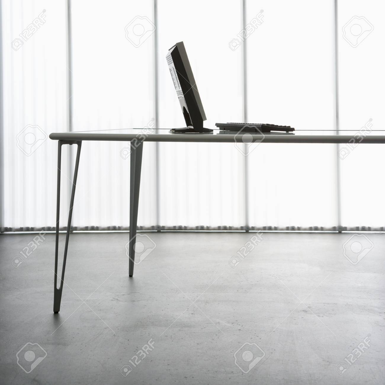 Computer monitor and keyboard on modern table. Stock Photo - 1868928