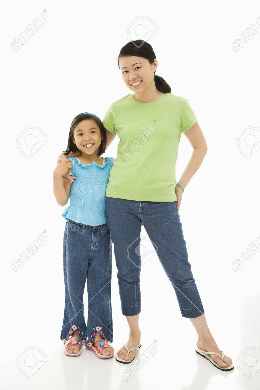 Asian mother and daughter standing with arms around eachother. Stock Photo - 1868984