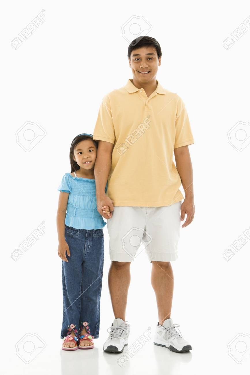 Asian father standing holding hands with daughter. Stock Photo - 1868862