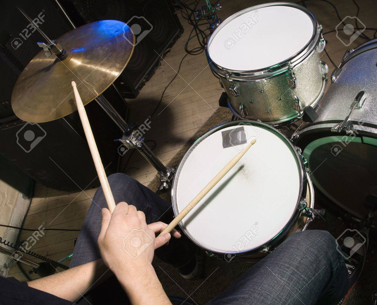 Above View Of Drummer S Hands Holding Drumsticks Playing On Drumset