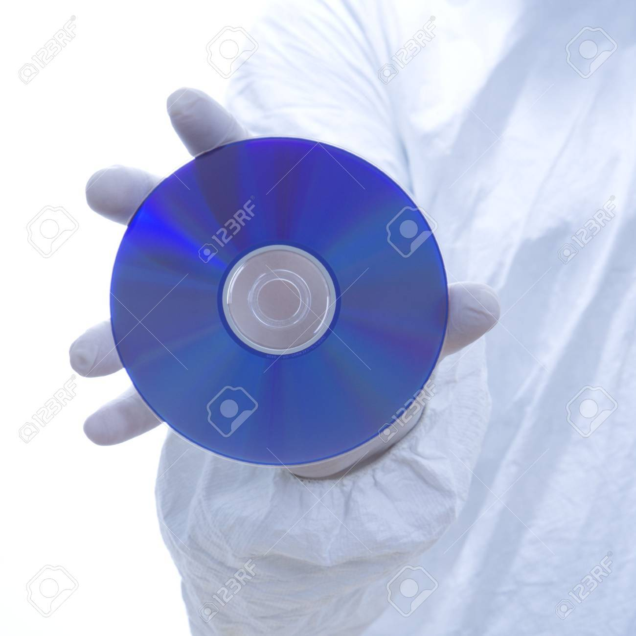 Close-up of man in biohazard suit and latex gloves holding compact disc. Stock Photo - 1906307
