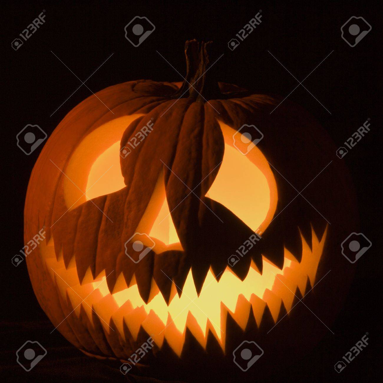 Carved Halloween pumpkin glowing in the dark. Stock Photo - 1906600