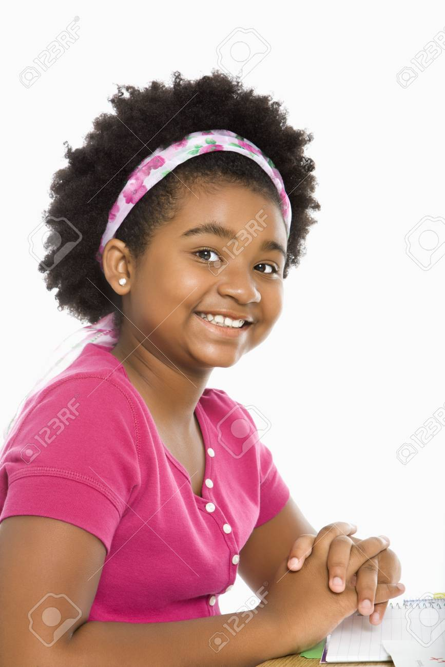 African American girl sitting in school desk smiling at viewer. Stock Photo - 1960904
