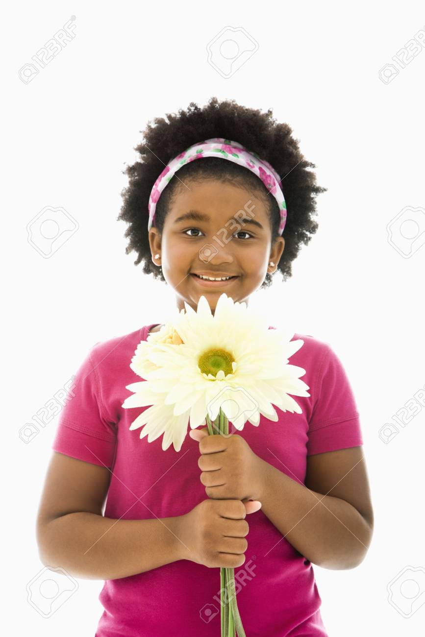 African American girl holding large Gerbera Daisies smiling at viewer. Stock Photo - 1960732