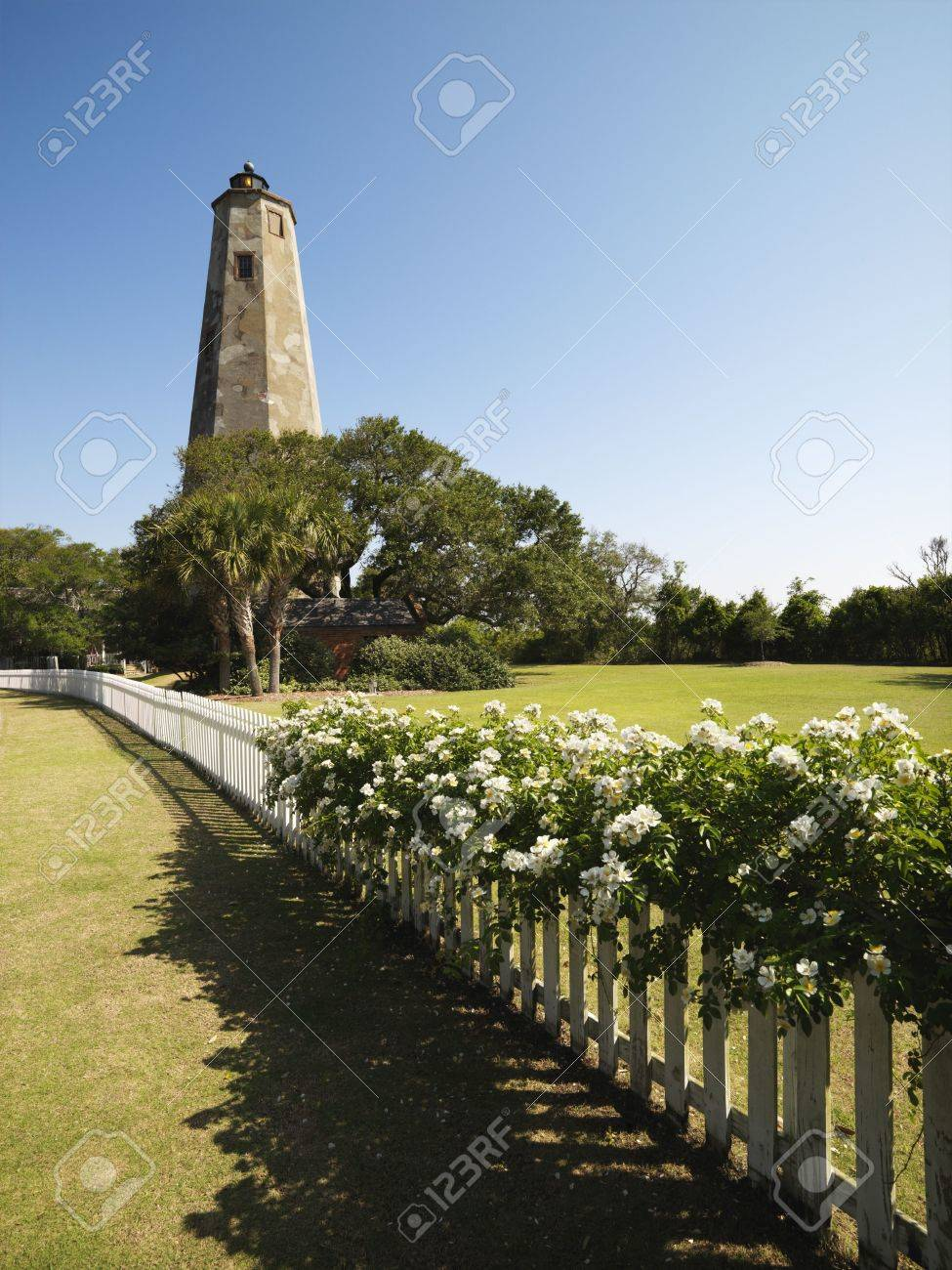 Bald Head Lighthouse With Fence And Wild Roses At Bald Head Island ...