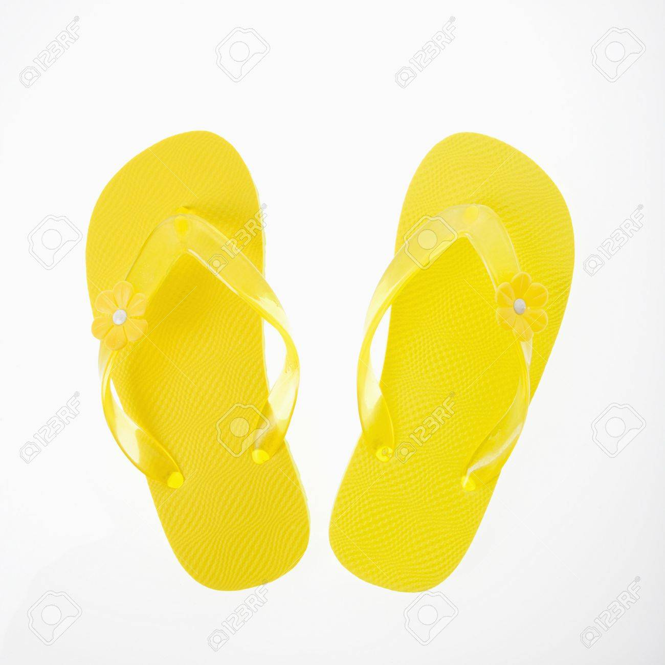 8bc6f9e64 Stock Photo - Yellow plastic thong sandals.