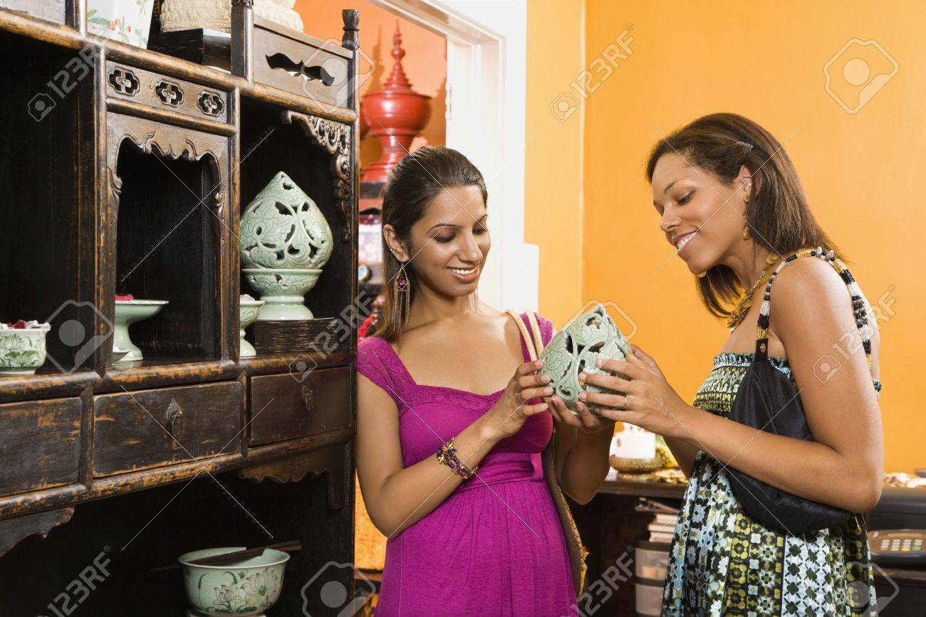african american and indian women shopping together for home decor stock photo 2061110 - Woman Home Decorating