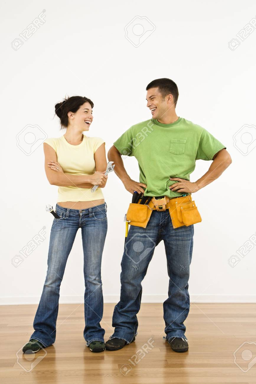 Couple with tools standing and smiling in home. Stock Photo - 2060885