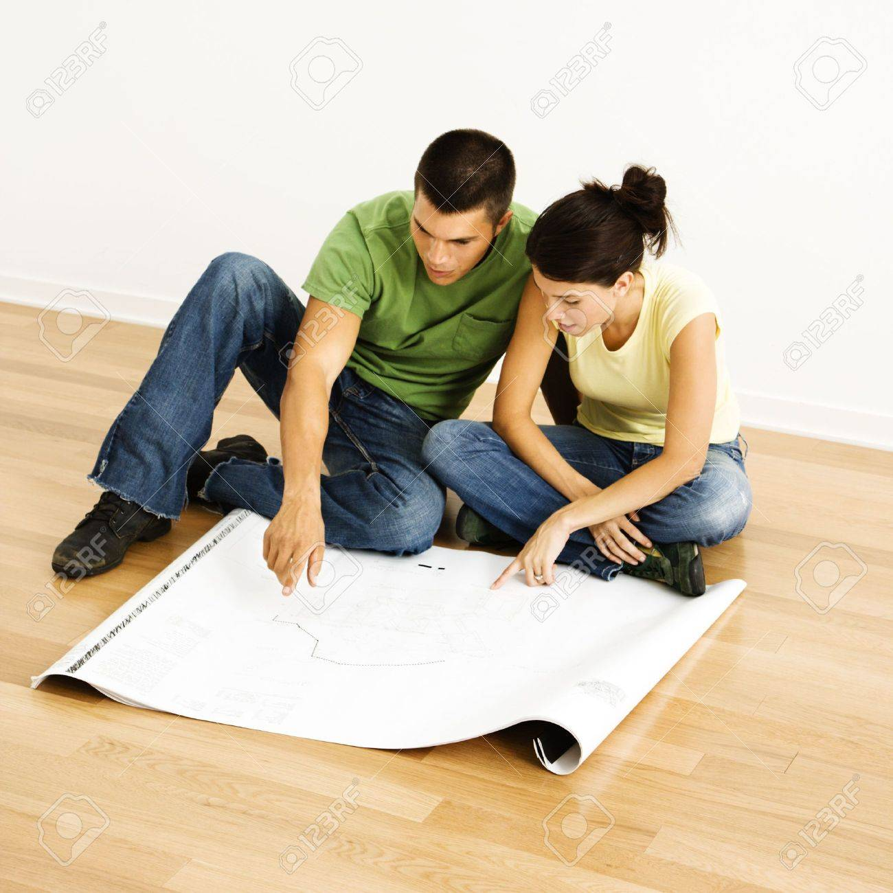 ttractive Young dult ouple Looking t House Plans. Stock Photo ... - ^