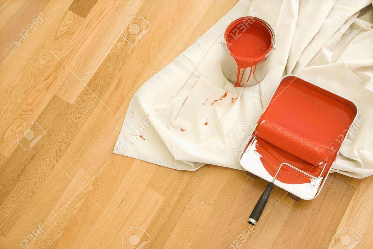 High angle view of painting supplies on drop cloth on wood floor. Stock Photo - 2043580