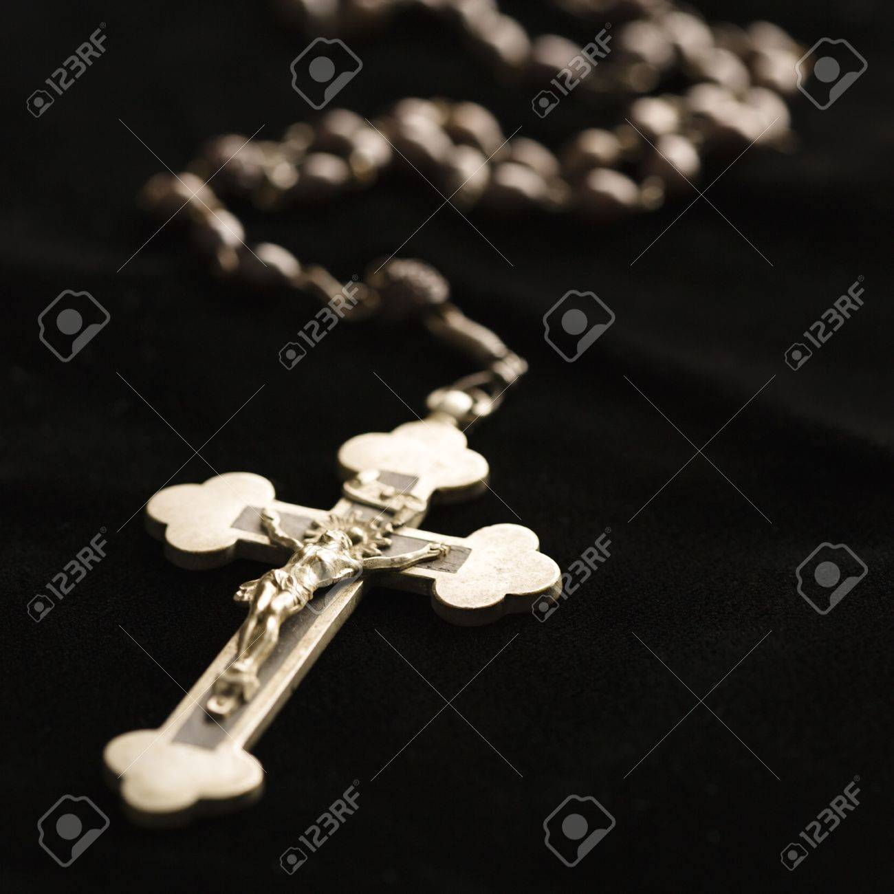 Christian rosary beads with crucifix on black background. Stock Photo - 2043808