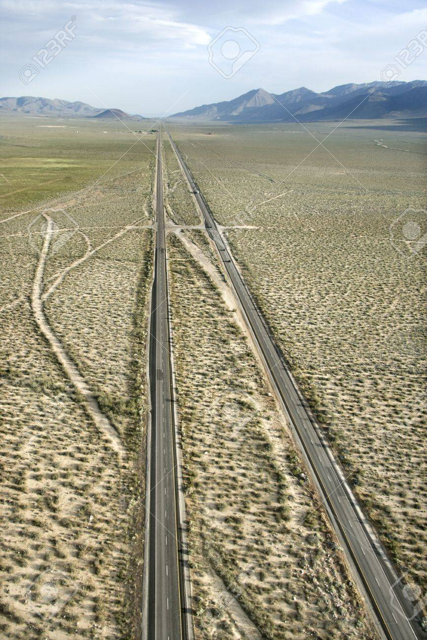 Aerial of desolate scenic highway through rural desert landscape of California, USA. Stock Photo - 2113950
