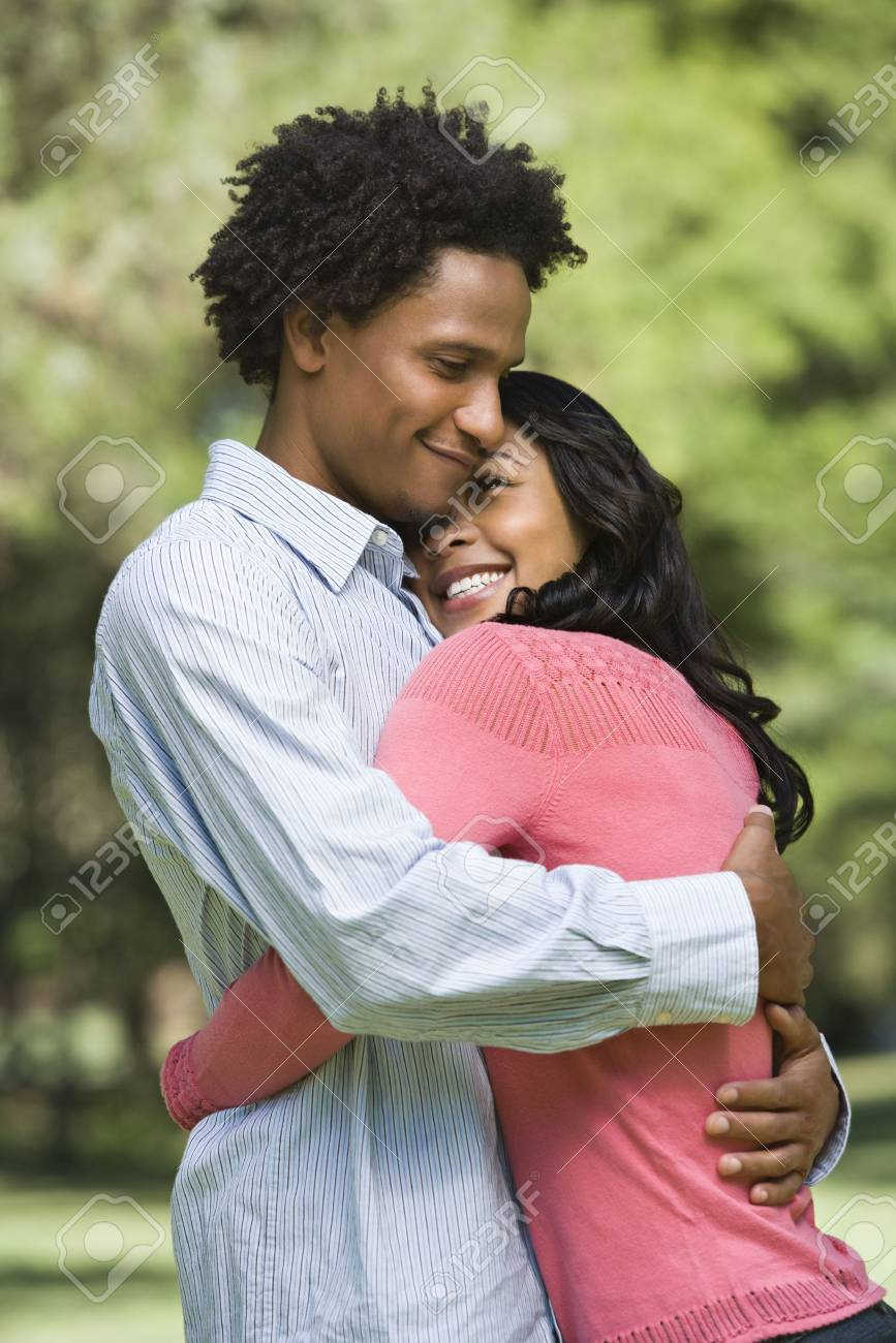 Attractive couple smiling and embracing in park. Stock Photo - 2115349