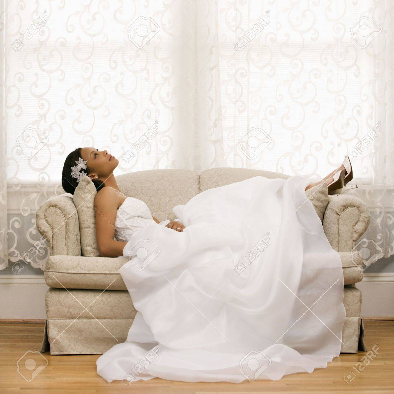 African-American bride lying on love seat. Stock Photo - 2145622