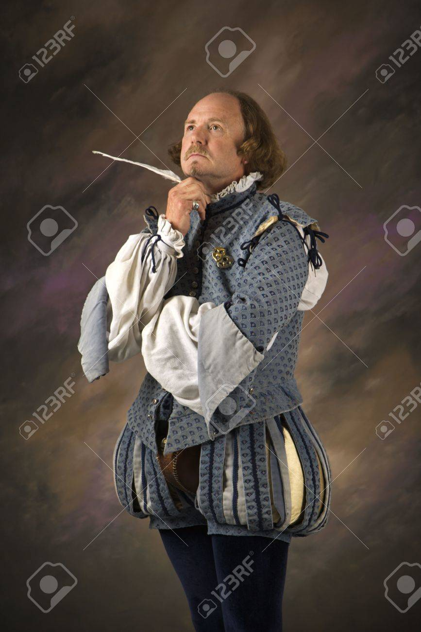 William Shakespeare in period clothing holding feather pen with thoughtful expression. Stock Photo - 2190054