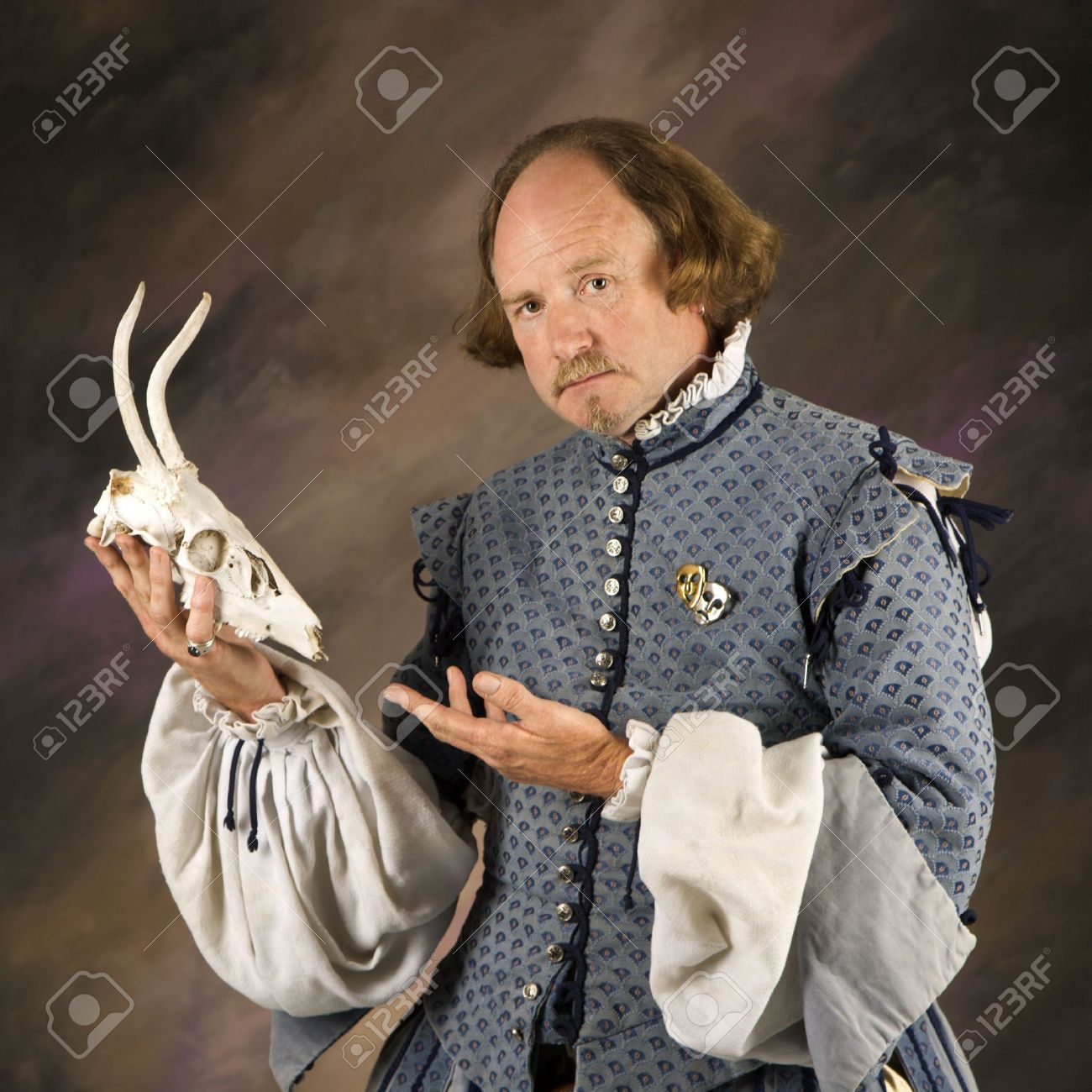 William Shakespeare in period clothing holding deer skull and looking at viewer. Stock Photo - 2145385