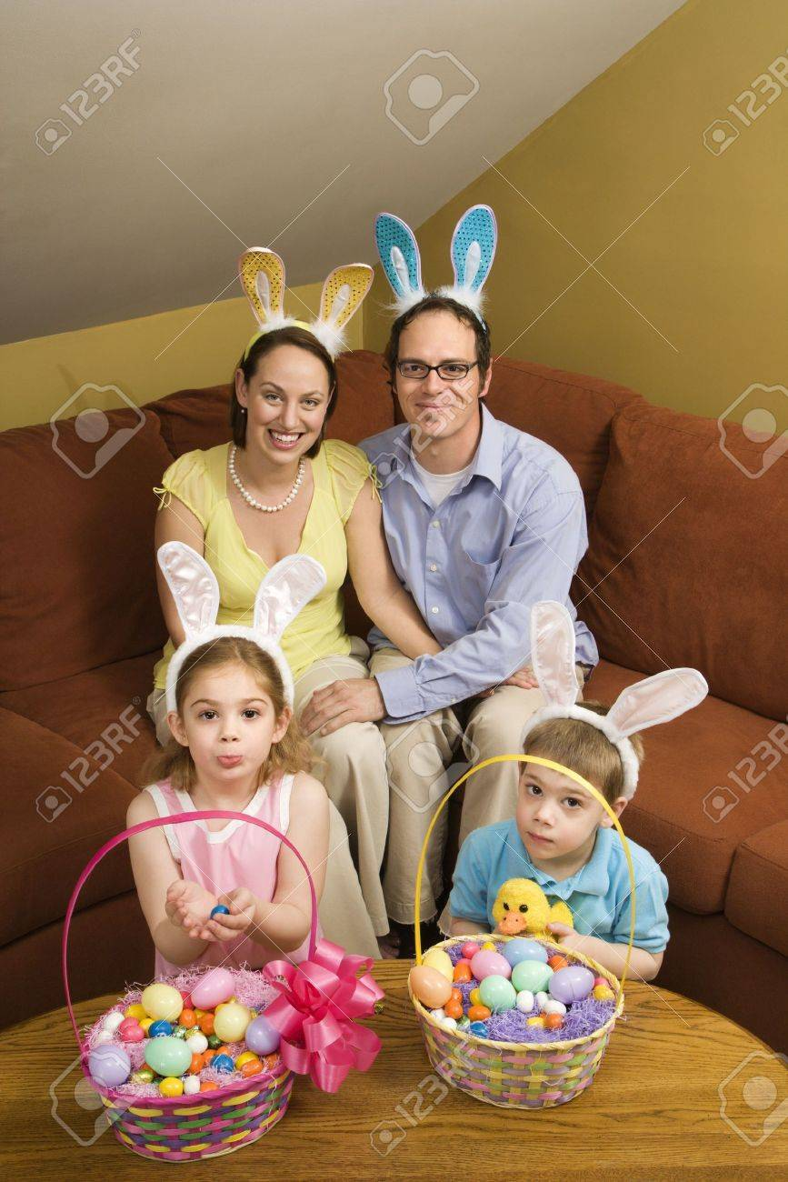 Caucasian family wearing rabbit ears with Easter baskets looking at viewer. Stock Photo - 2190112