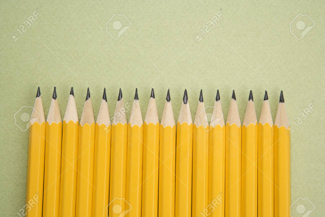 Sharp pencils arranged in an even row. Stock Photo - 2176062