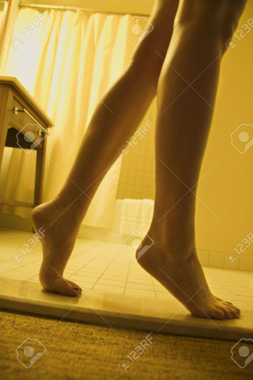 Bare legs and feet of woman standing on tiptoe in bathroom. Stock Photo - 2167926