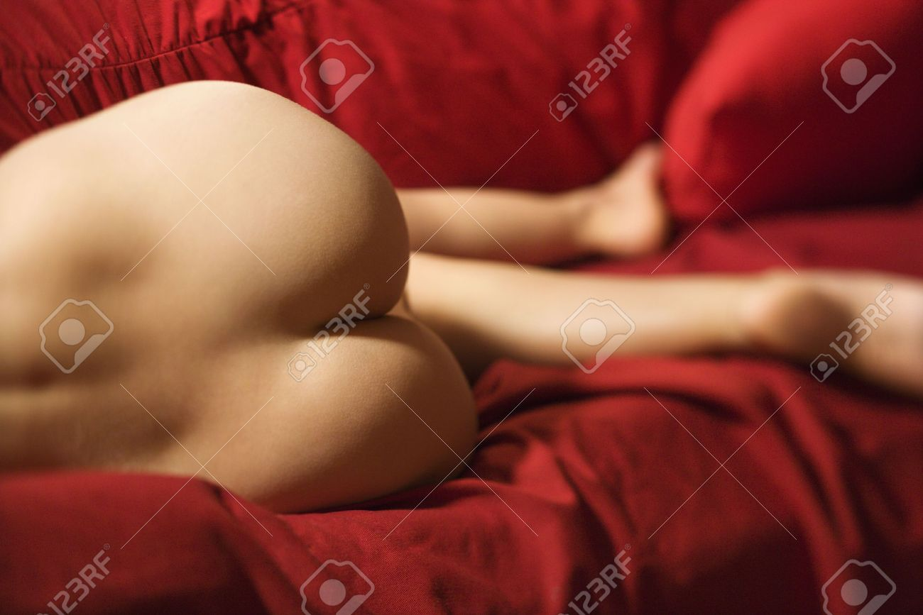 derriere of sexy nude caucasian young adult female lying seductively