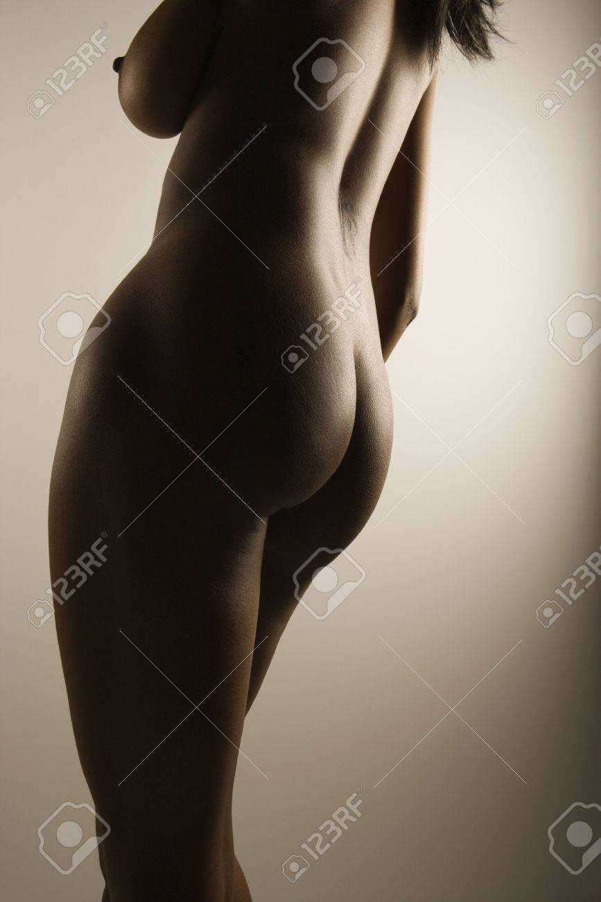 nude african american mid adult female with back to viewer showing