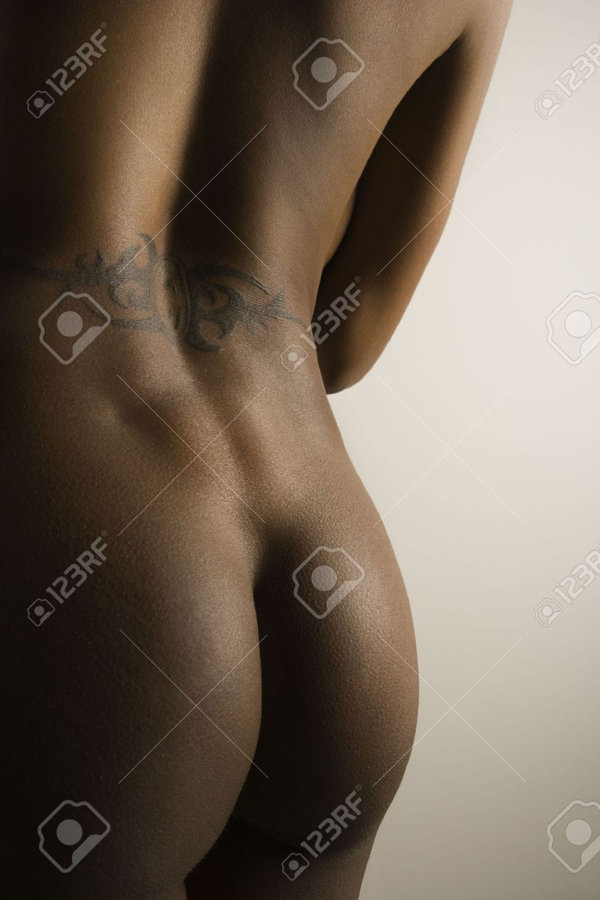 nude african american mid adult female buttocks and back with