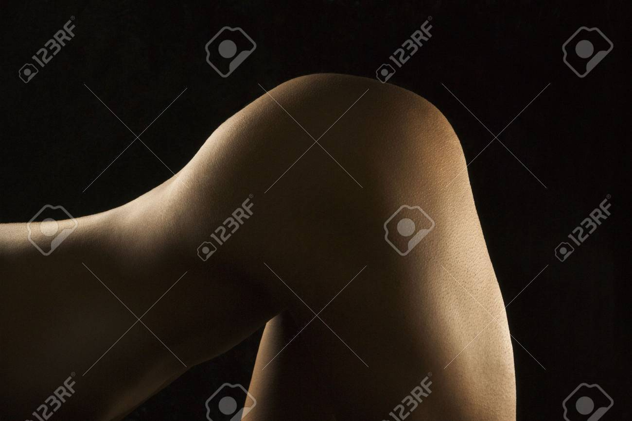 Nude Hispanic mid adult woman bending over at waist. Stock Photo - 2174157