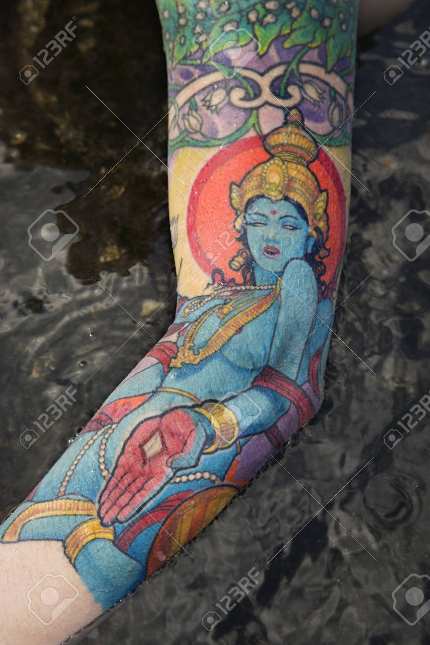 Arm of tattooed Caucasian woman by tidal pool in Maui, Hawaii, USA. Stock Photo - 2174151