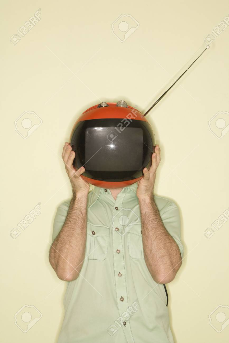 Caucasian mid-adult man holding round red retro television in place of head. Stock Photo - 2204908