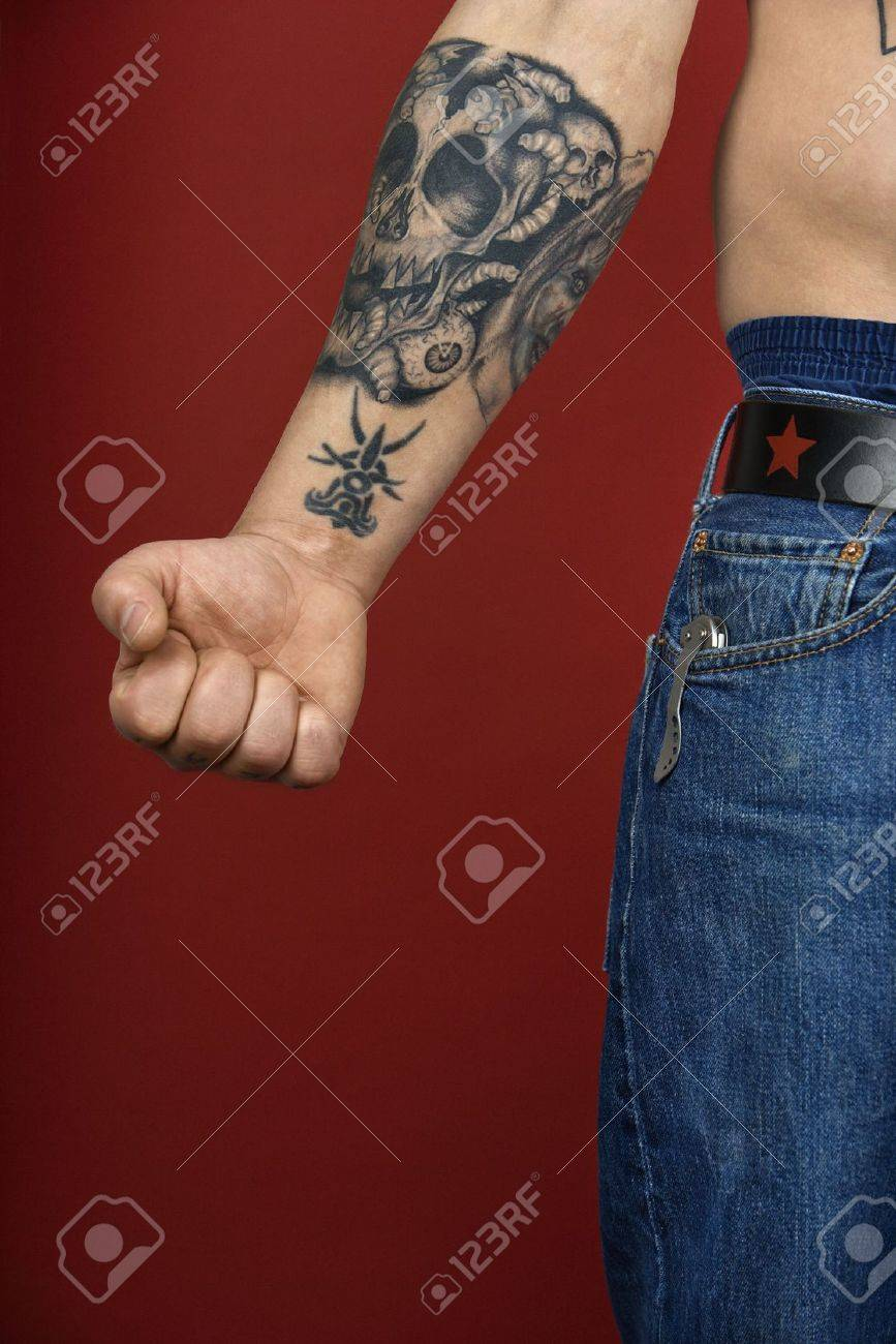 Caucasian mid-adult man's arm with tattoo. Stock Photo - 2215353