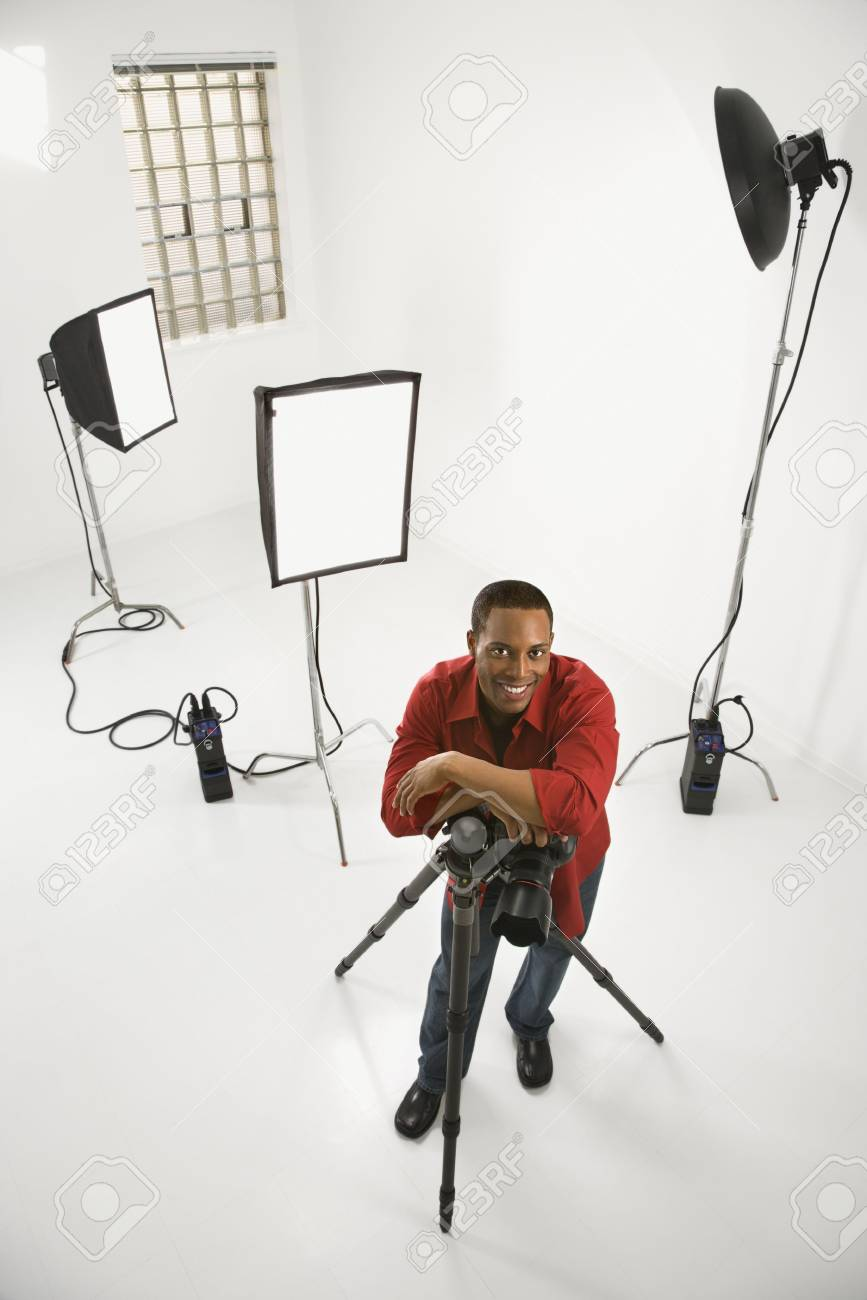 Young African American male adult photographer posing in studio. Stock Photo - 2376158