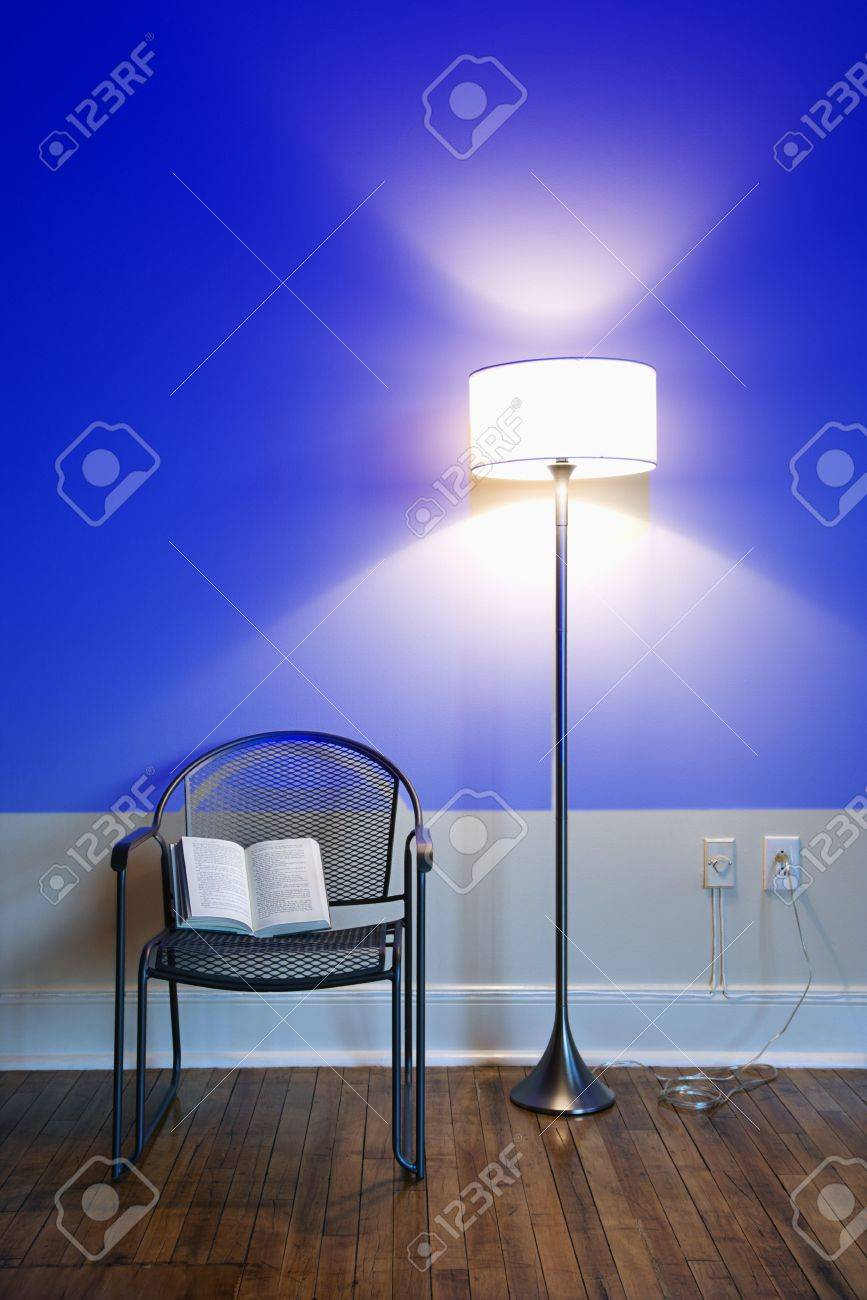 Blue Projection Light On Wall With Bright Floor Lamp And Open ...