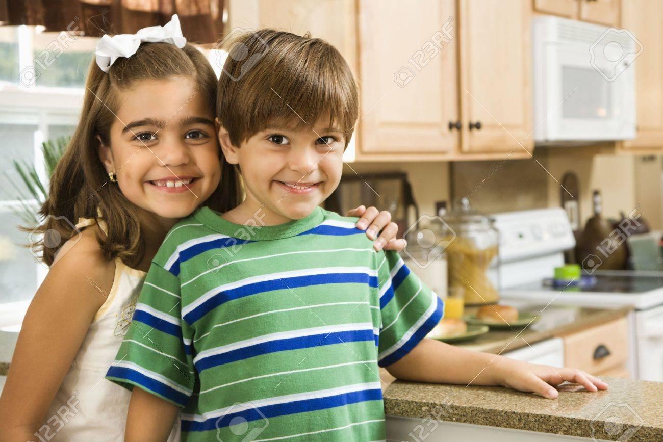 Hispanic children in kitchen smiling at viewer. Stock Photo - 2555861