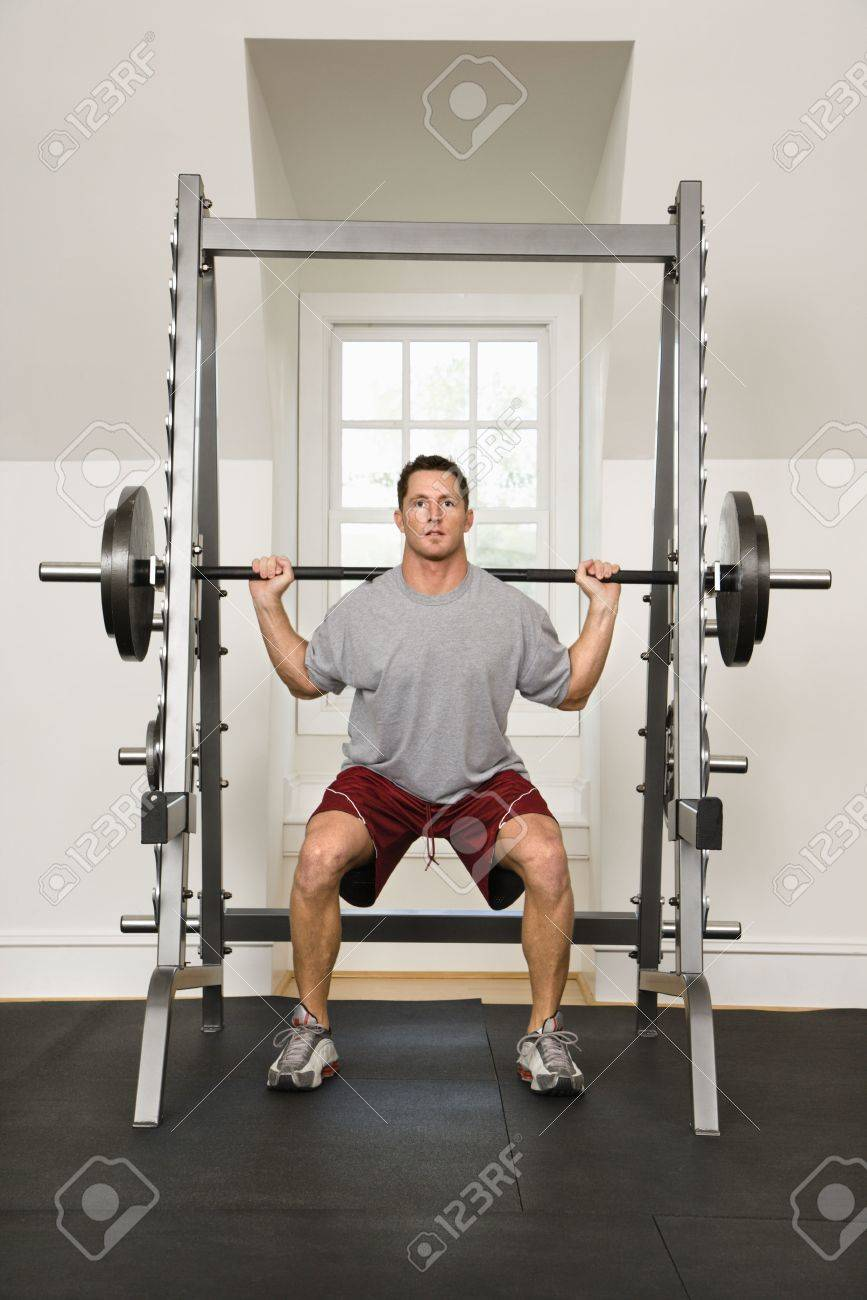 Man lifting weights in gym. Stock Photo - 2615755