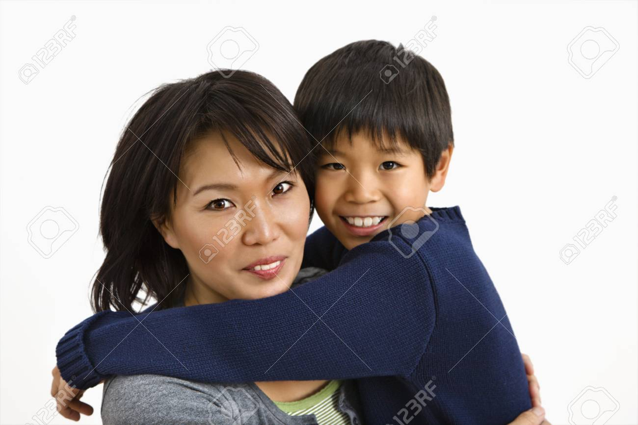 Asian mother and son hugging and smiling. Stock Photo - 2615788