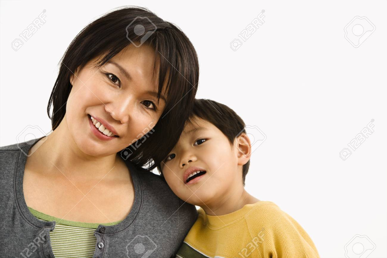 Portrait of Asian mother and young son leaning on eachother. Stock Photo - 2615950