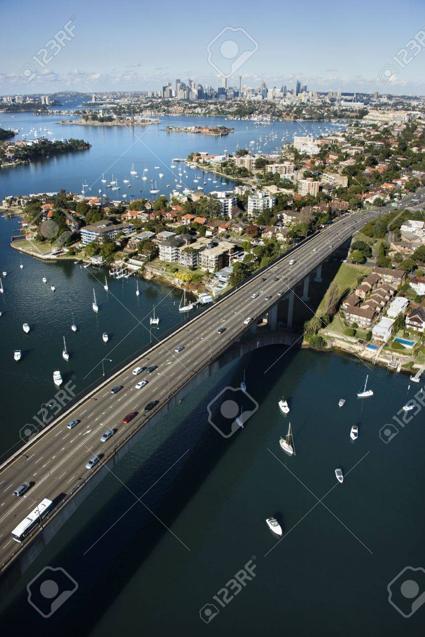 Aerial view of Victoria Road bridge and boats with distant downtown skyline in Sydney, Australia. Stock Photo - 2655242