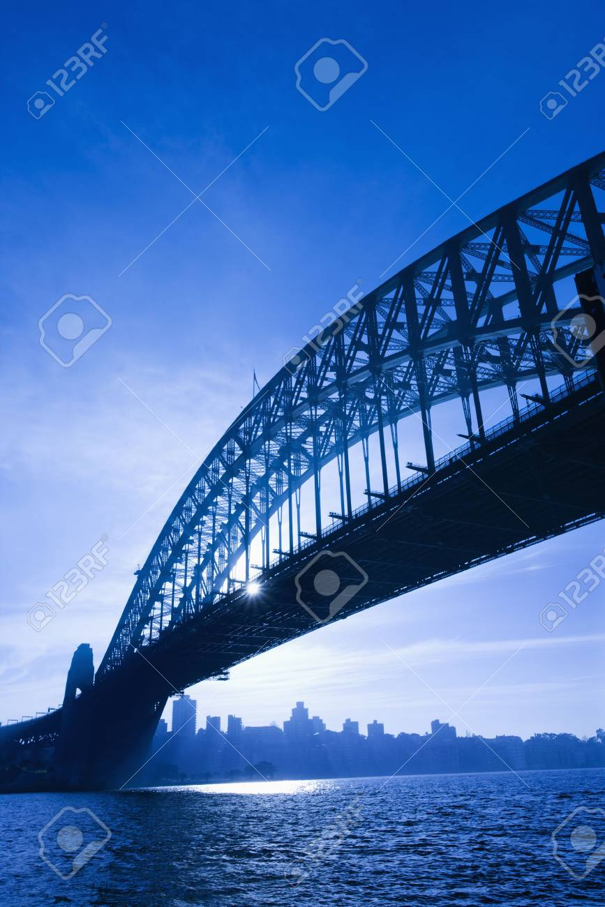 Sydney Harbour Bridge at dusk with view of distant skyline and harbour in Sydney, Australia. Stock Photo - 2654579
