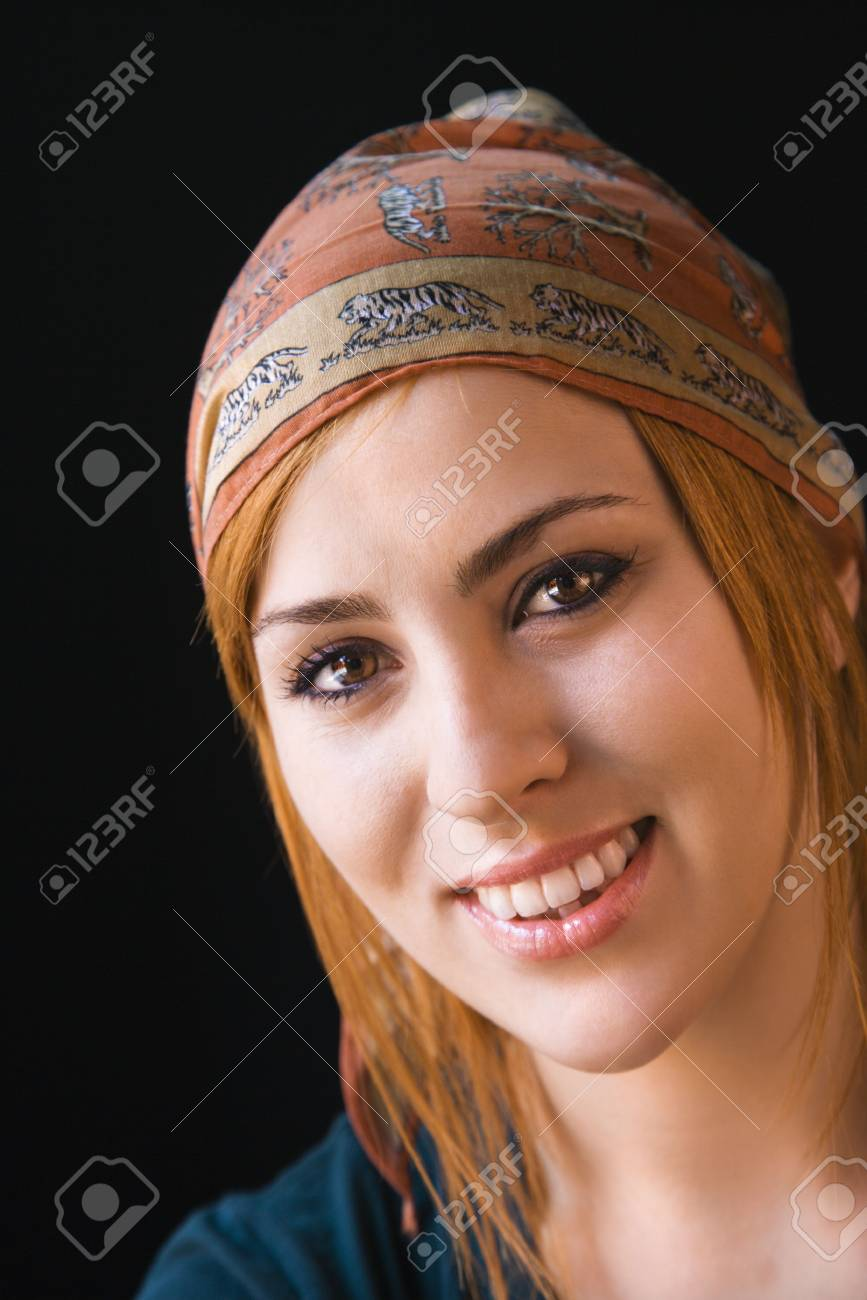 Young redheaded woman wearing cap smiling at viewer. Stock Photo - 3548320