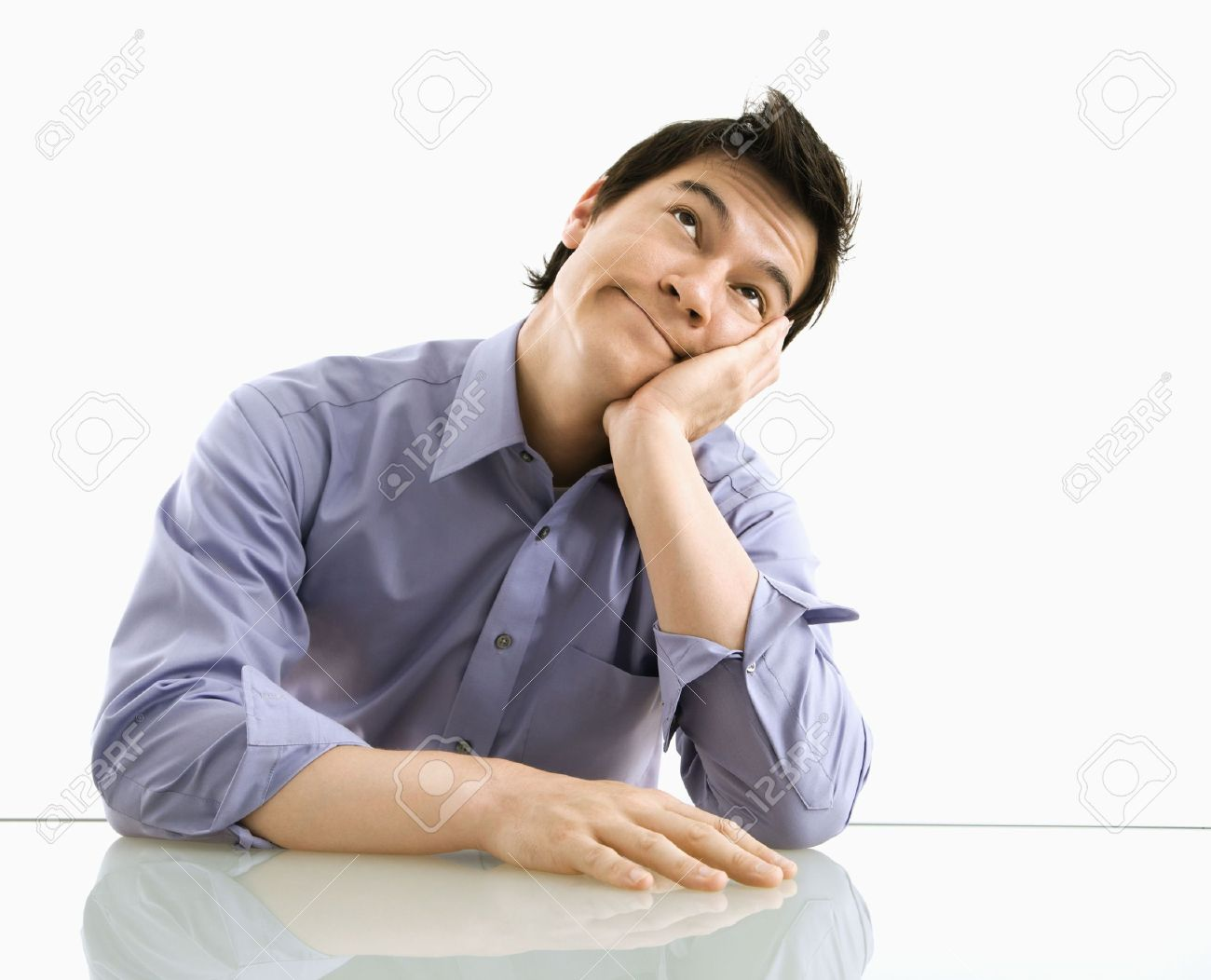 Young Asian Business Man Sitting Daydreaming Stock Photo Picture