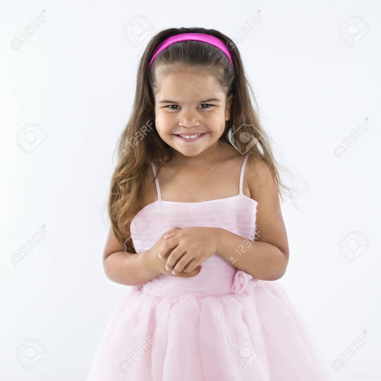 Cute little hispanic girl wearing pink dress smiling. Stock Photo - 3569347