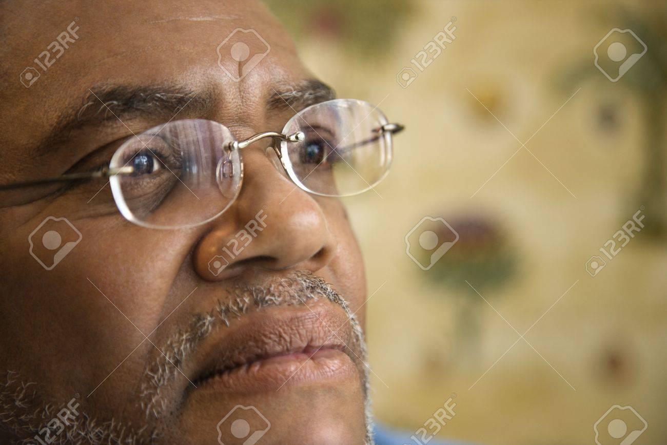 Portrait of senior black man in eyeglasses with serious expression. Horizontal shot. - 6302501